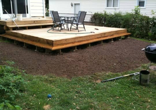 Freshly tamped 7,000 pounds of soil to fix the grading coming off the new deck. Circa 2010.