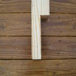 Notched end of the post. This end overhangs the side of the deck and was bolted securely in place.