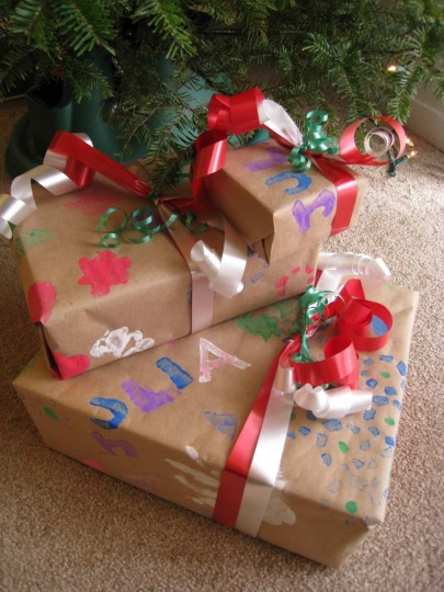 The wrapped presents under the tree.