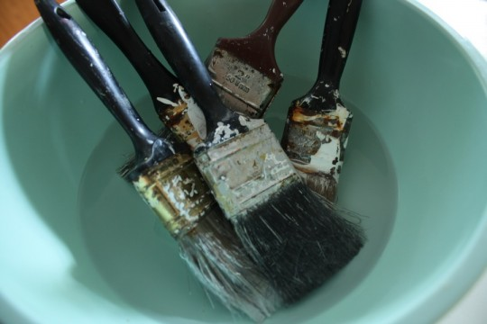 Soaking brushes in hot vinegar.