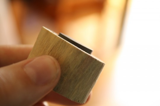 Close-up of magnet glued - note that it's not totally flush with the wood.