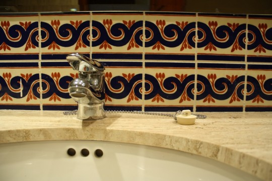 Pretty mexican tiles and countertop.