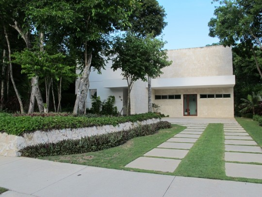 Pretty home with a simple paver driveway option.