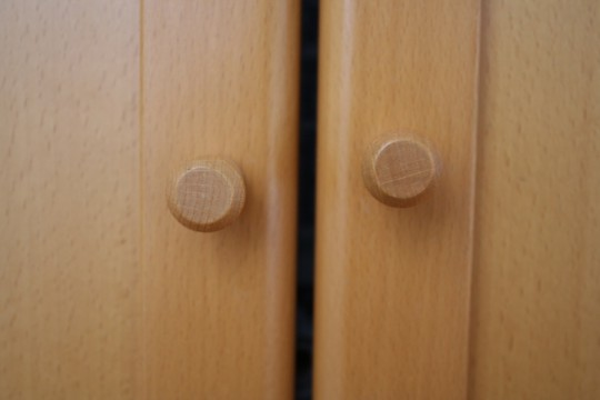 Existing knobs on the IKEA shelving. Uneven! Blasphemy.