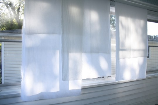 Three panels of future sunroom curtains. Letting the light shine through.
