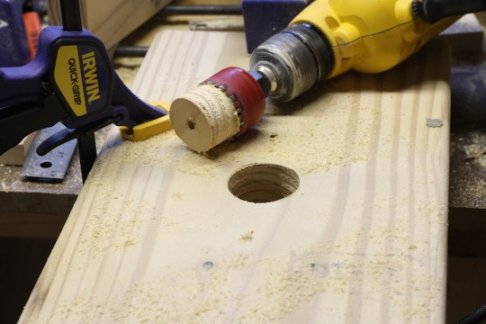 Drilling holes out of the top of the step stool for decoration and purpose.