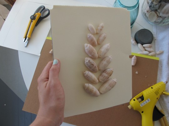 Custom shadow box art using craft paper and seashells