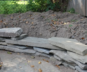 Create a garden border with scrap flagstone.