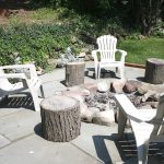 Just beyond the pergola, a built-in fire pit in their flagstone patio.