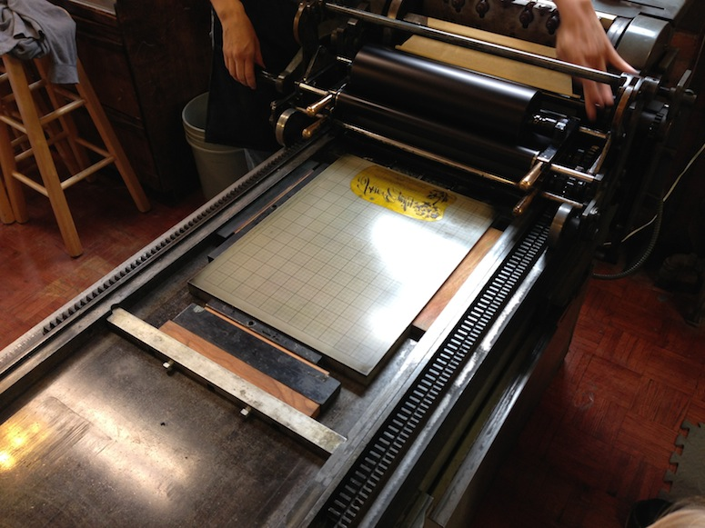 Checking out our custom invite plate on Fly Rabbit Run's letterpress.