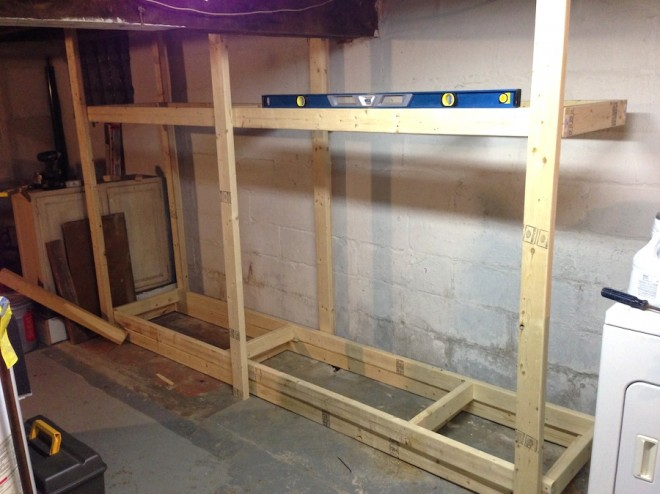 Creating basement shelves out of basic 2x4 boards.