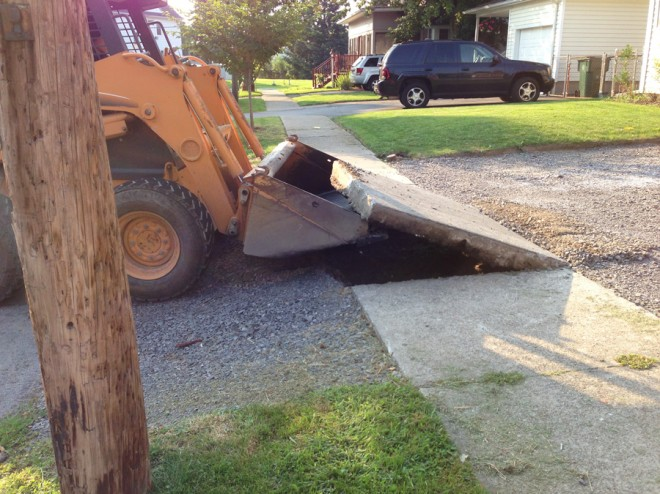 Removing the sidewalk in front of the house.