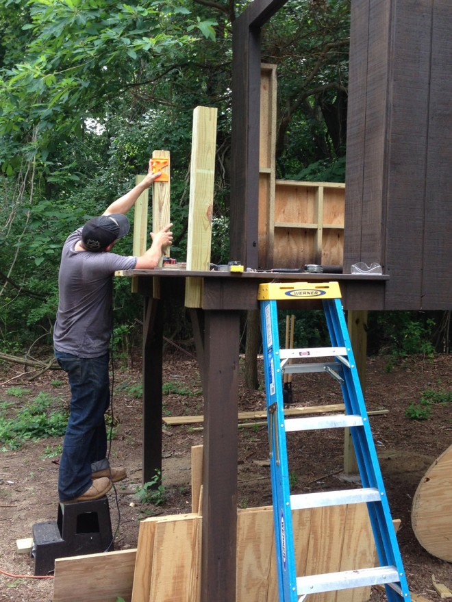 Installing the railings on our modern treehouse.