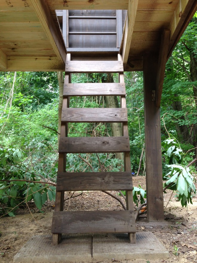The trap door ladder into our treehouse.