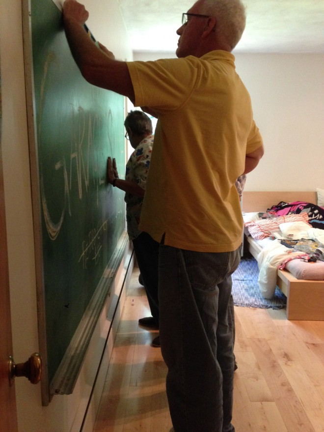 Installing the chalkboard in our kid's room.