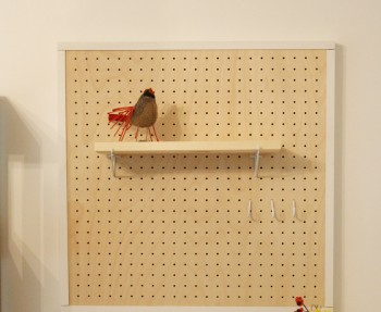 A pretty birch wood pegboard in our home. A DIY Network craft project.