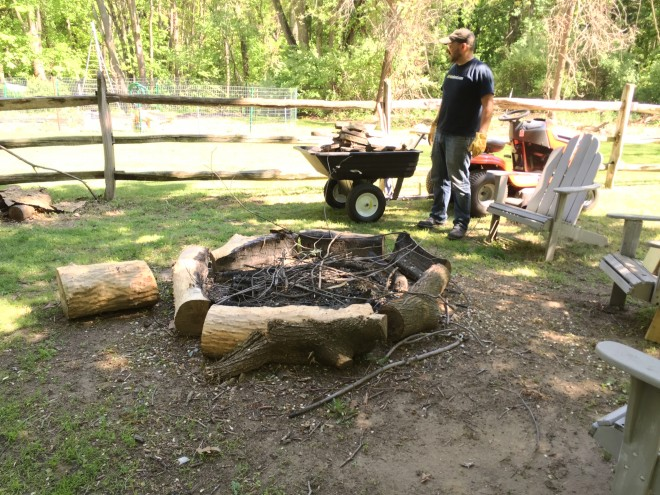 Fire pit with big log surround, and Pete.