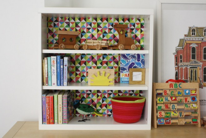 Decorating a plain shelf with colorful tissue paper.