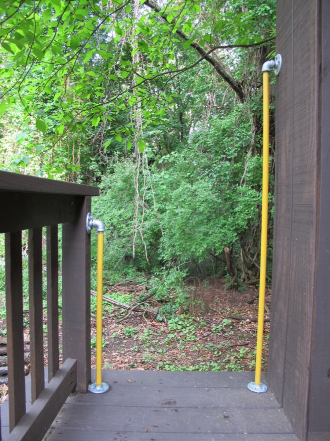 Handrails in the treehouse for ladder safety.