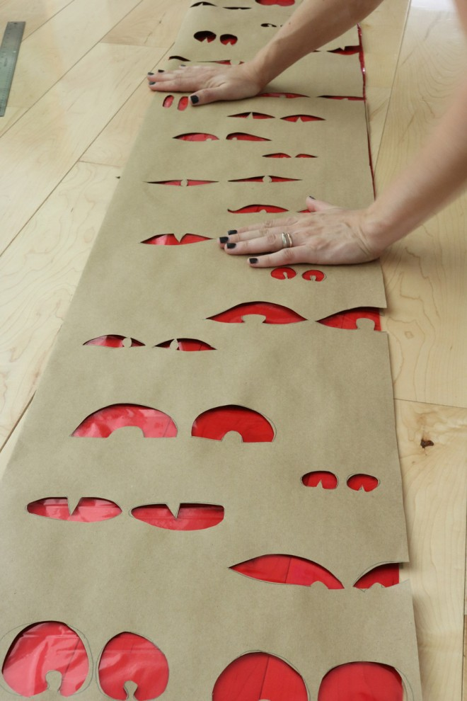 Use red shrink wrap or gift wrap to make red eyes in the window.