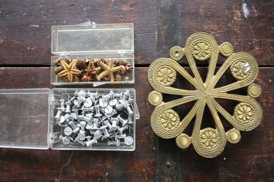 Trivet, push pins, and little starfish.