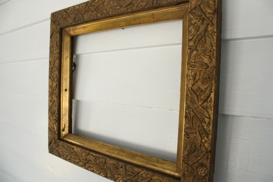 Gold, ornate frame.