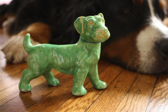 Little green dog. Totally useless. Totally adorable.