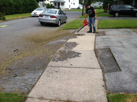 Driveway cleaning with the Black & Decker leaf blower.