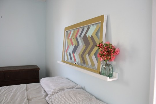 Updated headboard art with some fresh-cut azaleas.