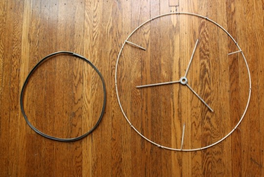 My two frame hardware components: A three pronged piece to attach to the lamp harp, and a custom hoop.