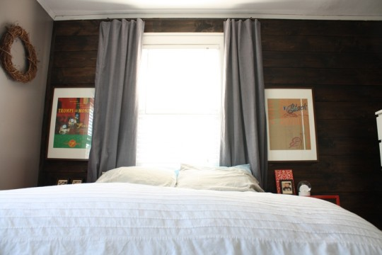 Bedroom, improved, thanks to some simple DIY'ed curtains and inexpensive art.