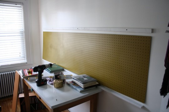 Pegboard in gold, looking much better in the bright room. The top of the frame has been anchored already in this shot too.