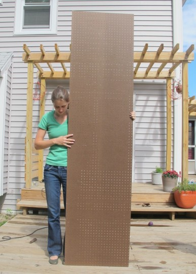 Big ol' piece of pegboard. Half of the 4'x8' sheet, equivalent to $5.