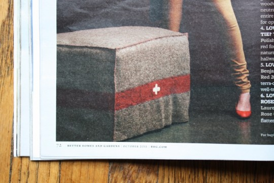 Ottoman slipcover made from a vintage swiss army blanket.