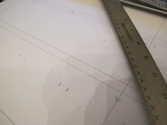 Planning where to line the thumbnail openings in the mat.
