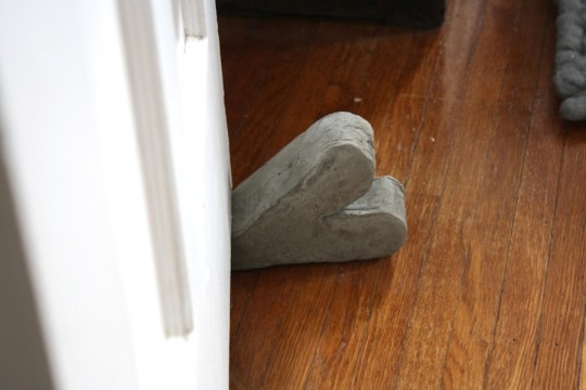 Finished portland cement doorstop.