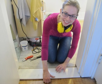 Installing a bathroom threshold.