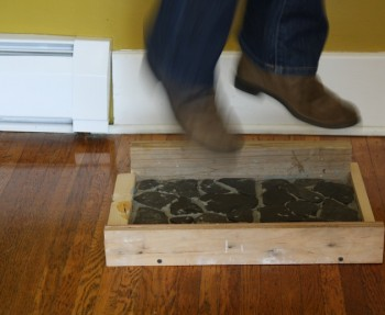 Entryway flooring test by stomping on shale.