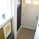 Entryway, with the cement floor and lush shiplap wall.