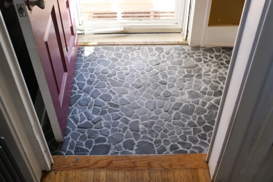 Finished entryway with a DIY stone floor.