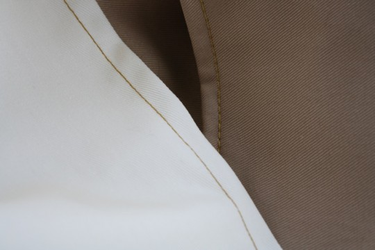 Sewn edge with rich golden thread.