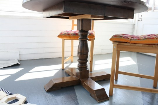 New sunroom table with a wooden pedestal base.