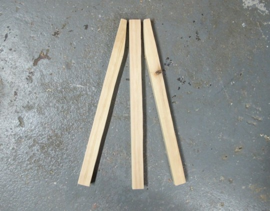 "Trio of 14"" pieces of wood. Future easel."