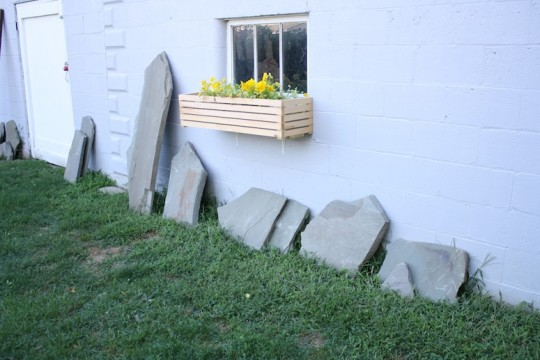 Leftover flagstone pieces alongside the garage.