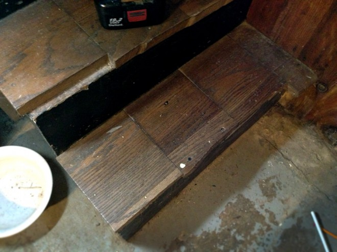 Repaired basement stair.