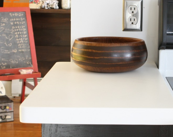 Pretty teak bowl painted with walnut stripes.