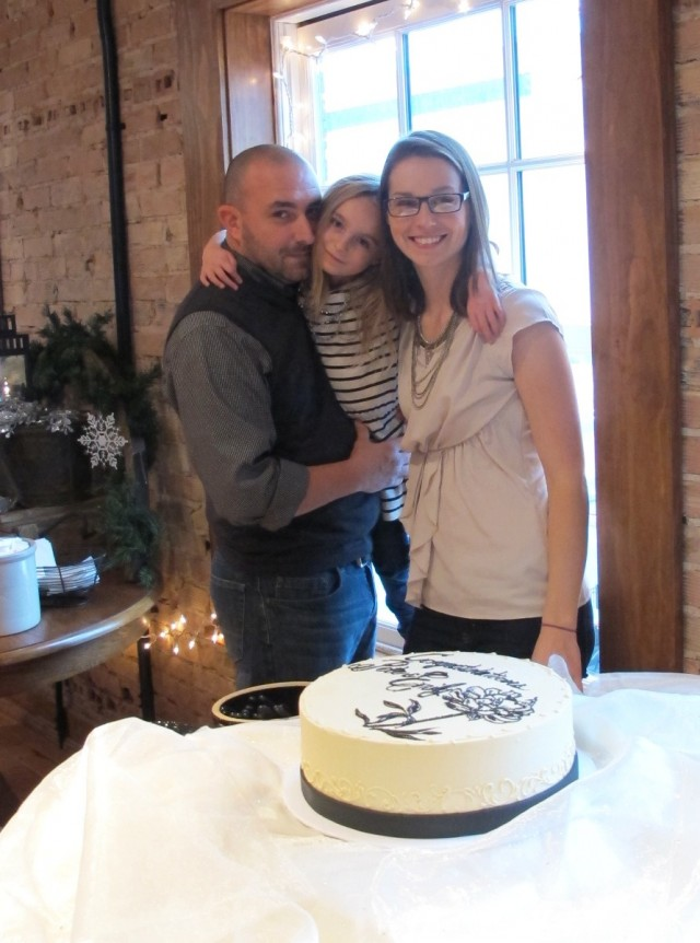 Pay no attention to weird shadows and bulky shirt layers, it's the only photo we have of the three of us at our wedding shower.