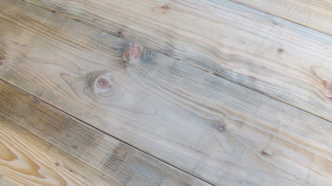 Lumber distressing using natural wood stain.