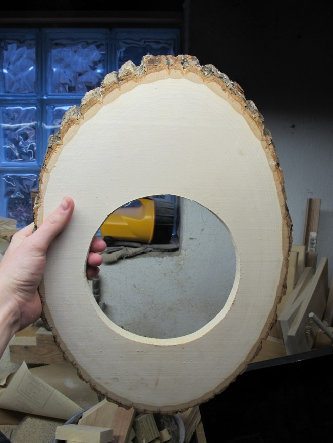 Cut a round hole in the wood panel.