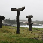 Basalt rock statues along the ocean.